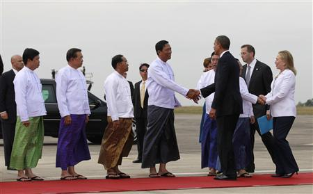 U.S. President Barack Obama (3rd R) and U.S. Secretary of State Hillary Clinton (R) shake hands with unidentified officials upon arriving at Yangon International Airport November 19, 2012. Obama has become the first serving U.S. president to visit Myanmar, arriving on Monday for a trip that will attempt to strike a balance between praising the government's progress in shaking off military rule and pressing it for further reforms. REUTERS/Jason Reed
