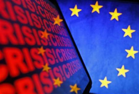 The logo of the European Union and the word crisis are displayed on the screen an iPad and a LCD monitor in Zenica November 16, 2012. REUTERS/Dado Ruvic