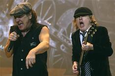 AC/DC lead vocalist Brian Johnson (L) and Angus Young performs at the O2 Millennium Dome stadium in London April 14, 2009. REUTERS/Luke MacGregor