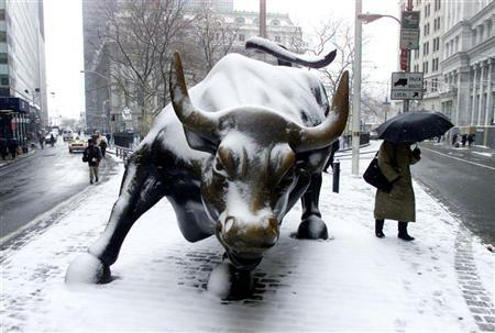 Snow covers the ''Charging Bull'' statue in New York's financial district on March 6, 2001. REUTERS/Peter Morgan