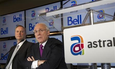 Bell Canada Enterprises (BCE) president and chief executive officer George Cope (L) and Ian Greenberg (R), president and chief executive officer of Astral Media Inc., speak at a news conference in Montreal, March 16, 2012. REUTERS/Christinne Muschi