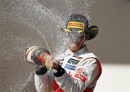 McLaren Formula One driver Lewis Hamilton of Britain sprays champagne during the podium ceremony after winning the U.S. F1 Grand Prix at the Circuit of the Americas in Austin, Texas November 18, 2012. REUTERS/Robert Galbraith