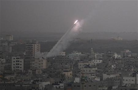 Smoke trails are seen as a rocket is launched from the northern Gaza Strip towards Israel November 17, 2012. Palestinian militants fired a rocket at Tel Aviv on Saturday but it was intercepted in mid-air by a newly deployed Israeli anti-missile battery and caused no casualties or damage, police said. REUTERS/Majdi Fathi