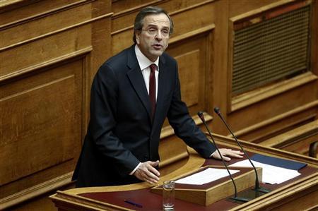 Greece's Prime Minister Antonis Samaras addresses parliamentarians before a voting for the 2013 budget in Athens November 11, 2012. REUTERS/Yorgos Karahalis