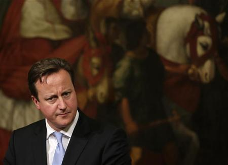 British Prime Minister David Cameron listens to a reporter's question during his joint news conference with Italian Prime Minister Mario Monti (not pictured) at the end of their meeting at Chigi Palace in Rome November 13, 2012. REUTERS/Tony Gentile