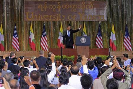 U.S. President Barack Obama waves after giving a speech at the University of Yangon November 19, 2012. REUTERS/Minzayar