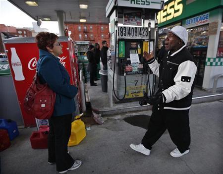 A man complains to people standing in line for gas at a Hess fuelling station in Brooklyn, New York, November 9, 2012. REUTERS/Brendan McDermid