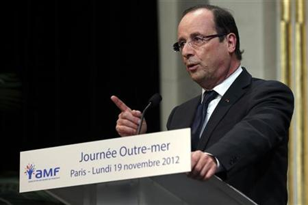 French President Francois Hollande delivers a speech during the ''Oversea Day'' of the French Mayors congress in Paris, November 19, 2012. REUTERS/Philippe Wojazer