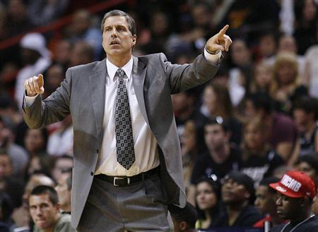 Washington Wizards' head coach Randy Wittman directs his team against the Miami Heat in the second half of their NBA basketball game in Miami, Florida April 21, 2012. REUTERS/Andrew Innerarity