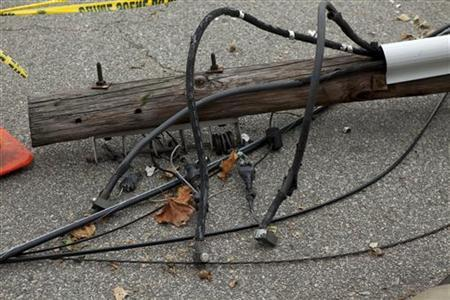 A fallen electric post belonging to the PSEG company is seen on a street in Union City, New Jersey, is this file photo taken November 2, 2012. REUTERS/Eduardo Munoz