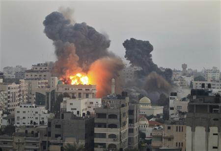 Smoke and explosion are seen after Israeli air strikes in Gaza City November 19, 2012. REUTERS/Mohammed Salem