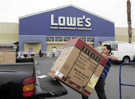 A contractor loads a bathroom vanity cabinet onto his truck after purchasing it at a Lowe's store in Burbank, California August 17, 2009. REUTERS/Fred Prouser