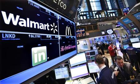 A board shows stock prices for Walmart at the booth they are traded on the floor of the New York Stock Exchange, March 6, 2012. REUTERS/Brendan McDermid