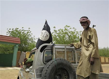 Fighters from the Islamic militant group the Movement for Unity and Jihad in West Africa (MUJWA) ride on a truck in the northeastern Malian city of Gao September 7, 2012. REUTERS/Adama Diarra