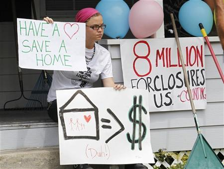 A member of the Poor People's Economic Human Rights Campaign take part in what they describe as a 'foreclosure takeover', at a site near where the Republican National Convention will take place in Tampa, Florida August 25, 2012. The convention starts on August 27. REUTERS/Joe Skipper