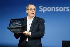 Paul Otellini, president and CEO of Intel Corporation, holds an ultrabook as he gives a keynote address during the 2012 International Consumer Electronics Show (CES) in Las Vegas, Nevada, in this January 10, 2012, file photo. Intel Corp. said on November 19, 2012, that Chief Executive Officer Paul Ottelini would retire in May, stepping down from the world's leading chipmaker at time when it is grappling with weak PC demand as the industry shifts towards mobile computing. REUTERS/Steve Marcus/Files