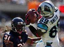 Carolina Panthers' wide receiver Steve Smith (R) catches a pass against Chicago Bears' free safety Brandon Meriweather during the first quarter of their NFL football game in Chicago, October 2, 2011. REUTERS/Jim Young