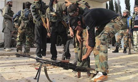 Free Syrian Army fighters prepare their weapons near the town of Atareb November 17, 2012. REUTERS/Abdalghne Karoof