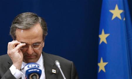 Greece's Prime Minister Antonis Samaras adjusts his glasses as he attends a news conference at the end of the second session of a two-day European Union leaders summit in Brussels October 19, 2012. REUTERS/Christian Hartmann