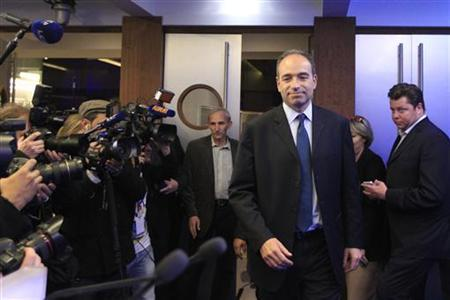French politician Jean-Francois Cope (2ndR) arrives at a news conference at the UMP political party headquarters in Paris after he won the leadership of France's main conservative party in a closely fought and divisive two-way contest November 19, 2012. REUTERS/Gonzalo Fuentes