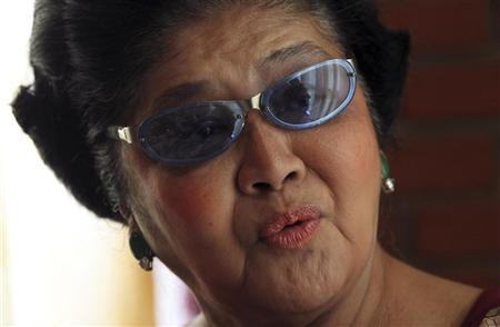 Former Philippine first lady Imelda Marcos answers questions during an interview at the Fort Ilocandia Resort in Laoag city, north of Manila May 13, 2010. REUTERS/Romeo Ranoco