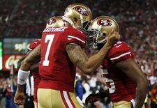 San Francisco 49ers quarterback Colin Kaepernick (7) congratulates wide receiver Michael Crabtree after Crabtree scored a touchdown during the third quarter of their NFL football game against the Chicago Bears in San Francisco, California, November 19, 2012. REUTERS/Beck Diefenbach