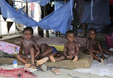 Children sit in a tent belonging to the National Emergency Management Agency (NEMA) at a relief centre for flood victims in Patani community of Delta state October 13, 2012. REUTERS/Tife Owolabi