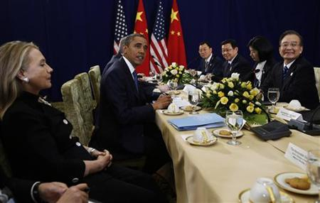 U.S. President Barack Obama (2nd L) meets with Chinese Premier Wen Jiabao (R), as U.S. Secretary of State Hillary Clinton (L) looks on, at the East Asia Summit in Phnom Penh, November 20, 2012. REUTERS/Jason Reed