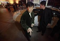 "Kung Fu superstar Jackie Chan gestures in front of a car before having his Bentley 666 auctioned for charity in Beijing, November 19, 2012. Chan said that while the upcoming film ""Chinese Zodiac 2012"" will be his last major action movie, citing his increasing age, he will still be packing punches in the world of philanthropy. Chan wrote, directed and produced his latest film, set to premiere in cinemas next month. He also plays the lead role and said that it was probably his ""best film for myself"" in the last ten years. Picture taken November 19, 2012. REUTERS/Petar Kujundzic"