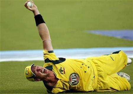 Australia's Dan Christian celebrates while taking a catch to dismiss Pakistan's Nasir Jamshed during their second Twenty20 international cricket match in Dubai September 7, 2012. REUTERS/Nikhil Monteiro/Files