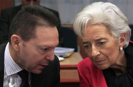 Greece's Finance Minister Yannis Stournaras (L) talks with International Monetary Fund (IMF) Managing Director Christine Lagarde at a Eurogroup meeting in Brussels November 12, 2012. Euro zone finance ministers and officials meet in Brussels on Monday to discuss the situation in Greece, but are not expected to authorize more money for Athens because there is still no agreement on how to make its debts sustainable. REUTERS/Yves Herman (BELGIUM - Tags: POLITICS BUSINESS)