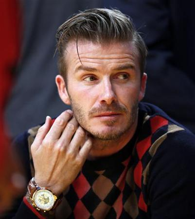 Soccer player David Beckham watches the Los Angeles Lakers play the San Antonio Spurs in their NBA basketball game in Los Angeles, November 13, 2012. REUTERS/Lucy Nicholson