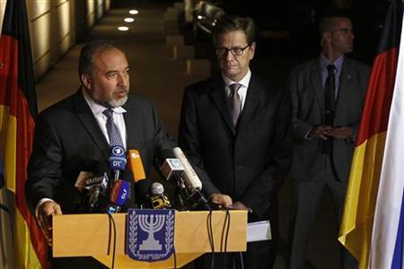Israel's Foreign Minister Avigdor Lieberman (L) speaks as he delivers joint statements to the media with his German counterpart Guido Westerwelle (2ndL) in Jerusalem November 19, 2012. Israel bombed dozens of targets in the Gaza Strip on Monday and said that while it was prepared to step up its offensive by sending in troops, it preferred a diplomatic solution that would end Palestinian rocket fire. REUTERS/Ronen Zvulun (JERUSALEM - Tags: POLITICS CIVIL UNREST)