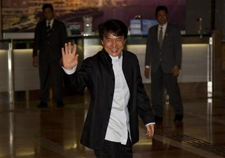 Hong Kong actor Jackie Chan attends the wedding ceremony of retired four-time Olympic diving champion Guo Jingjing and Kenneth Fok Kai-kong, the grandson of Hong Kong late billionaire tycoon Henry Fok Ying-tung in Hong Kong November 11,2012. REUTERS/Tyrone Siu