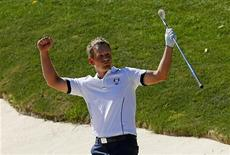 Team Europe golfer Luke Donald of England reacts to his sand shot that won his match against U.S. golfer Bubba Watson on the 17th green during the 39th Ryder Cup singles golf matches at the Medinah Country Club in Medinah, Illinois September 30, 2012. REUTERS/Mike Blake