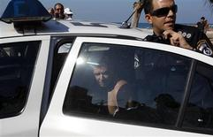 An Israeli police officer (R) stands beside a man who was arrested, near the U.S. embassy in Tel Aviv November 20, 2012. The man stabbed a security guard at the U.S. embassy in Tel Aviv on Tuesday and was apprehended, a police spokesman said, and Israel Radio reported the assailant was an Israeli with a criminal background. REUTERS/Baz Ratner