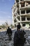 Macerie nei pressi di Damasco dopo un attacco aereo delle forze governative del presidente Bashar al-Assad . REUTERS/Omar al-Khani