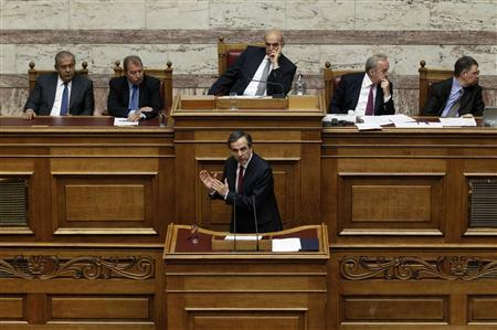Greece's Prime Minister Antonis Samaras addresses parliamentarians before a voting for the 2013 budget in Athens November 11, 2012. REUTERS/Yorgos Karahalis