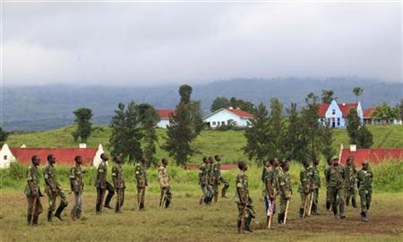 Recruits of the newly formed Congolese Revolutionary Army perform a military drill during training in Rumangabo military camp, Democratic Republic of Congo, October 23, 2012. REUTERS/James Akena/Files