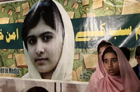 Pakistani students stand by a portrait of Malala Yousufzai as they attend a meeting organized by South Asian Women in media to mark ''Malala Day'' in Lahore November 10, 2012. REUTERS/Mohsin Raza