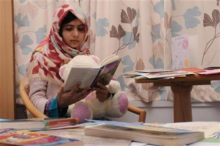 Pakistani schoolgirl Malala Yousufzai reads a book as she recuperates at the The Queen Elizabeth Hospital in Birmingham, in this undated handout photograph released November 8, 2012. REUTERS/Queen Elizabeth Hospital Birmingham/Handout