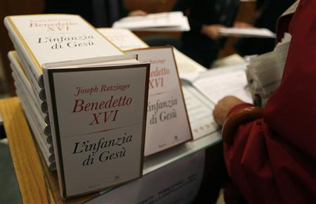 Journalists receive a copy of Pope Benedict XVI's book ''The Childhood of Jesus'' during a presentation in Vatican November 20, 2012. REUTERS/Alessandro Bianchi