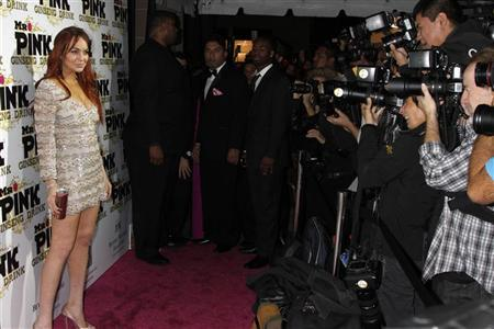 Actress Lindsay Lohan poses as she arrives for the Mr. Pink Ginseng Drink launch party at the Beverly Wilshire Hotel in Beverly Hills, California, October 11, 2012. REUTERS/Jonathan Alcorn
