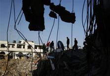 Palestinians inspect a destroyed house after what witnesses said was an Israeli air strike in Gaza City November 20, 2012. The U.N. chief called for an immediate ceasefire in the Gaza Strip on Tuesday and U.S. Secretary of State Hillary Clinton headed to the region with a message that escalation of the week-long conflict was in nobody's interest. REUTERS/Mohammed Salem (GAZA - Tags: MILITARY CONFLICT)