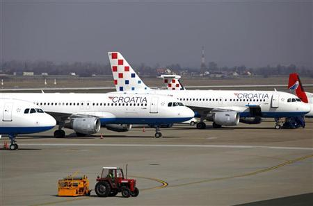 Croatia Airlines aircraft are seen on the tarmac at Pleso international airport in Zagreb March 8, 2012. REUTERS/Antonio Bronic