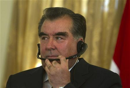 Tajik President Imomali Rakhmon uses a headphone during a news conference in Kabul October 25, 2010. REUTERS/Ahmad Masood