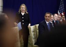 U.S. Secretary of State Hillary Clinton reacts as she arrives last for a meeting between President Barack Obama and Japan's Prime Minister Yoshihiko Noda at the East Asia Summit in Phnom Penh, November 20, 2012. REUTERS/Jason Reed