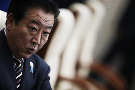Japan's Prime Minister Yoshihiko Noda prepares for a session of the 21st ASEAN (Association of Southeast Asian Nations) and East Asia summit in Phnom Penh November 20, 2012. REUTERS/Damir Sagolj