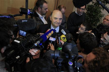 France's Finance Minister Pierre Moscovici speaks to journalists after a news conference at the Economy Ministry in Paris November 20, 2012. France said its economy was sound and reforms were on track after credit ratings agency Moody's stripped it of the prized triple-A badge due to an uncertain fiscal and economic outlook. Monday's downgrade, which follows a cut by Standard & Poor's in January, was expected but is a blow to Socialist President Francois Hollande as he tries to fix France's finances and revive the euro zone's second largest economy. REUTERS/Gonzalo Fuentes