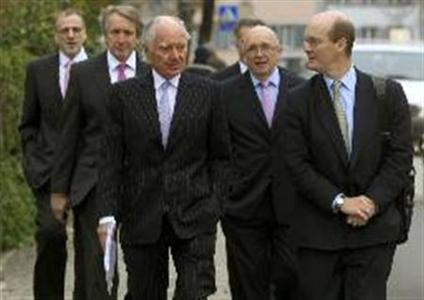 Xstrata Chairman John Bond (3rdL) and Chief Financial Officer Trevor Reid (2ndL) are accompanied by unidentified staff members as they arrive before an extraordinary shareholder meeting in the Swiss town of Zug November 20, 2012. REUTERS/Arnd Wiegmann
